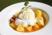 Mix fruit flambe banana orange and apple with ice cream — Stock Photo