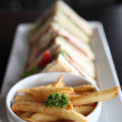 Club sandwich with on wood background — Stock Photo