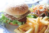 Hamburger with fries and salad — Stock Photo