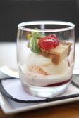Strawberry icecream with cheese cake — Stock Photo