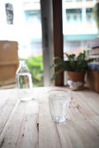 Water in glass in wood background — Stock Photo