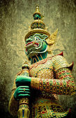 Ancient giant sculpture of The Emerald Buddha temple in Bangkok — Stock Photo