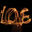 "Inscription ""Love"" from sparklers — Stock Photo"