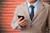 Man holding smartphone — Stock Photo