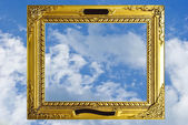 Old antique gold frame over white background — Stock Photo