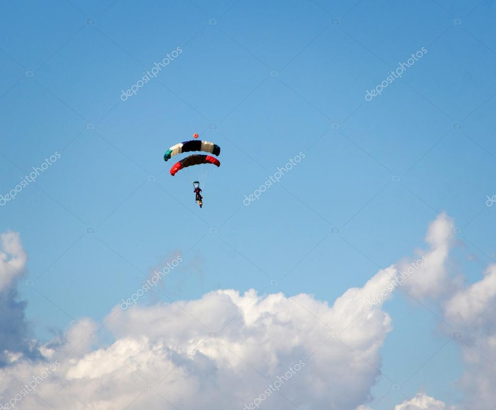 Skydivers in blue cloudy sky background — Stock Photo #13436898