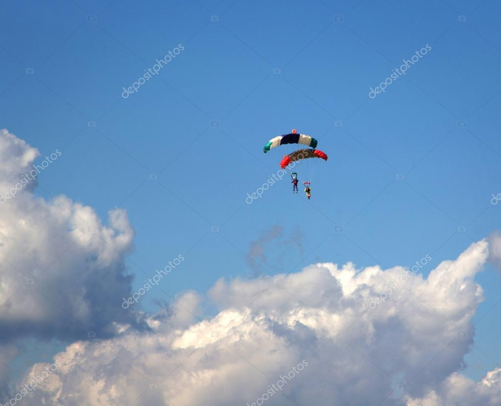 Skydivers in blue cloudy sky background  Stock Photo #13436906