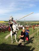 Knight on bucking horse — Stock Photo
