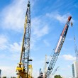 Stock Photo: Crane working on a Construction site.
