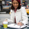 Woman Jotting Down Notes — Stock Photo
