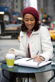 Woman Jotting Down Notes — Foto de Stock