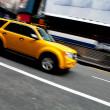 Speeding NYC Taxi SUV — Stock Photo