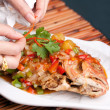 Food Stylist Plating Fish — Stock Photo #26501629
