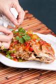 Food Stylist Plating Fish — Stock Photo