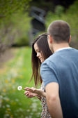 Woman Holding a Dandelion — Stock Photo