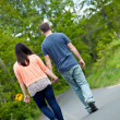 Man and Woman Walking in Street — Stock Photo #30396965