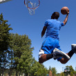 Stock Photo: MDunking Basketball