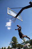 Slam Dunking a Basketball — Stock Photo