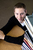 Student Looking At Book Stack — Stock Photo
