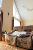 Lazy Man Laying on the Sofa — Stock Photo