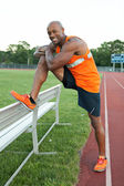 Track Runner Stretching — Stock Photo
