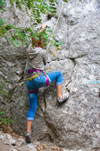 Young female rock climber — Photo