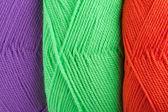 在绿色、 橙色和紫色的颜色纱绞的背景 — 图库照片