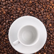 Stock Photo: White cup on beans background