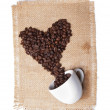 White cup with coffee beans on burlap background. heart symbol. — Stock Photo