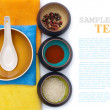 Stock Photo: Ceramic bowls with spices and rice on color placemat with sample
