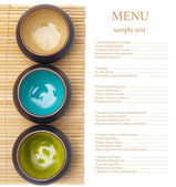 Empty ceramic bowls on bamboo placemat with sample text — Stock Photo