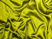 Gold silk textile background — Stock Photo