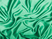 Wave background of green silk texture — Stock Photo