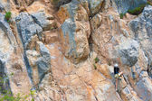 Female rock climber — Stock Photo