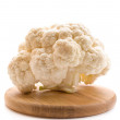 Cauliflower and chopping board — Stock Photo #19979983