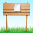 Wooden sign with paper sheet on green grass. — Stock Vector