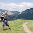 Tourist on the background of the Crimean Mountains — Stock Photo #41559449
