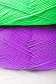 Background of yarn skeins in green, purple and white colors — Stock Photo