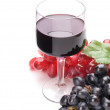 Glass of black wine and grapes on white background — Stock Photo