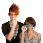 Eccentric Couple Adjusting Glasses — Stock Photo