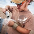 Stock Photo: Movie Crew Member Pouring Explosive Powder