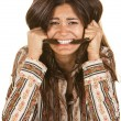 Frantic Woman Biting Her Hair - Stockfoto