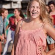 Stock Photo: Blond Teenage Girl Laughing