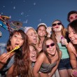 Teen Girls Blowing Bubbles — Stock Photo #13127725