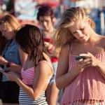 Serious Teenagers on Smartphones — Stock Photo