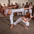 Capoeria Fighters Demonstrating Martial Arts - Stock Photo