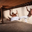 Stock Photo: Two Martial Artists in Mid-air