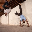 Capoeria Martial Artists Flipping — Stock Photo