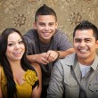 Latino Family Laughing Together — Stock Photo #13127805