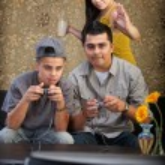 Funny Hispanic Family Playing Video Games — Stock Photo